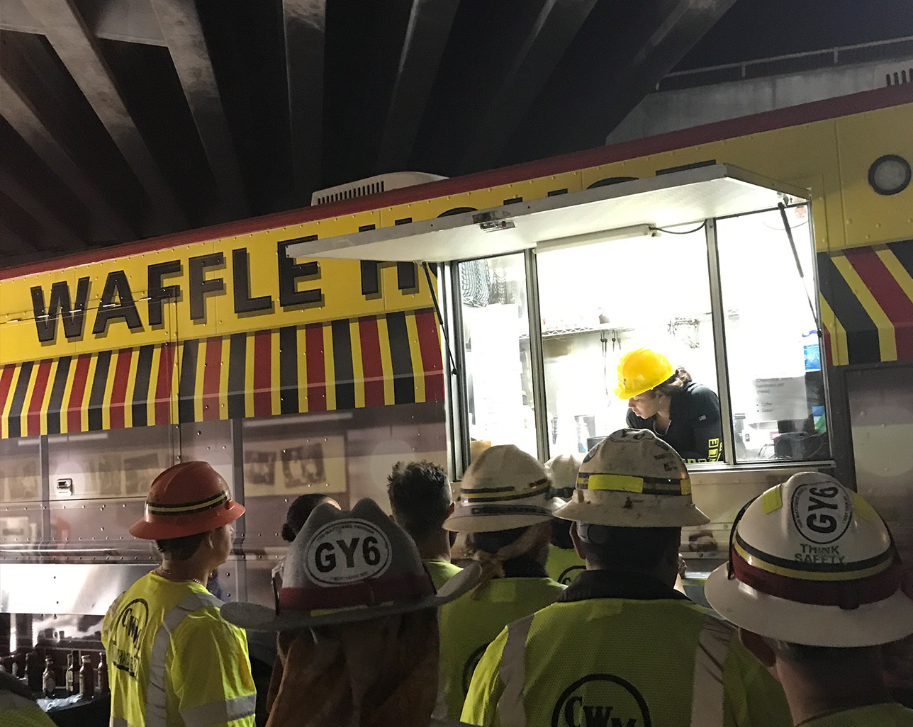 customers lined up at Waffle House food truck
