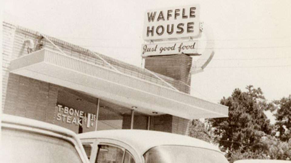 Black and white photo of original Waffle House sign