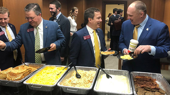 Buffet of Waffle House food at corporate event