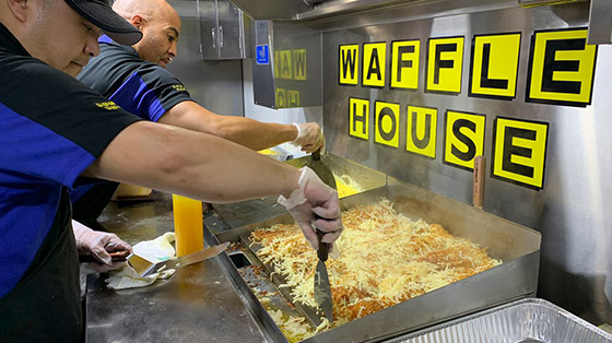 Hashbrowns cooking inside Waffle House food truck